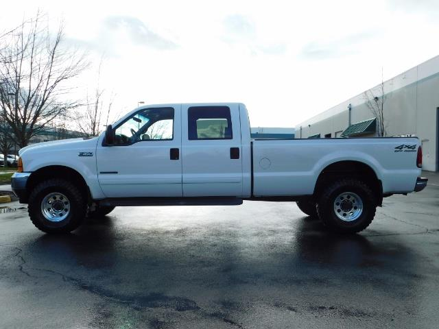 2001 Ford F-350 Super Duty Lariat / 4X4 / 7.3L DIESEL / LIFTED - Photo 3 - Portland, OR 97217