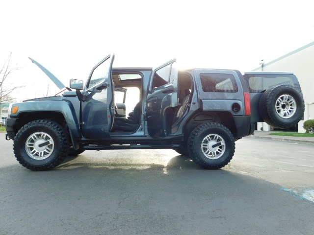 2006 Hummer H3 4dr SUV / 4WD / Sunroof / LIFTED / MUD TIRES - Photo 27 - Portland, OR 97217