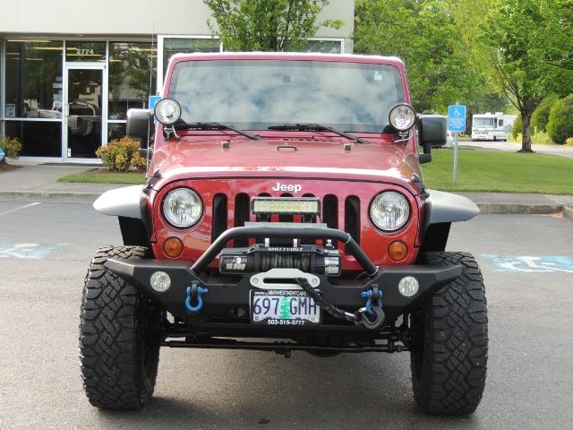 2011 Jeep Wrangler Unlimited Sport / 4X4 / 6-SPEED / LIFTED - Photo 5 - Portland, OR 97217