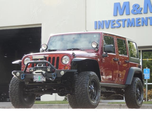 2011 Jeep Wrangler Unlimited Sport / 4X4 / 6-SPEED / LIFTED - Photo 44 - Portland, OR 97217