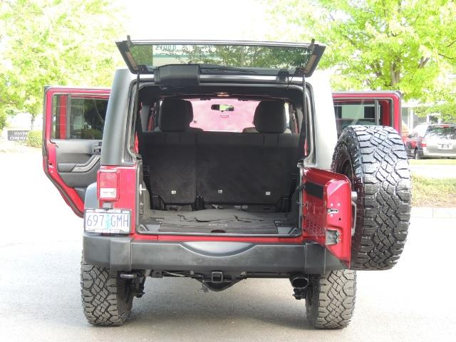 2011 Jeep Wrangler Unlimited Sport / 4X4 / 6-SPEED / LIFTED - Photo 17 - Portland, OR 97217