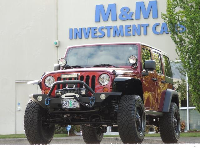 2011 Jeep Wrangler Unlimited Sport / 4X4 / 6-SPEED / LIFTED - Photo 48 - Portland, OR 97217