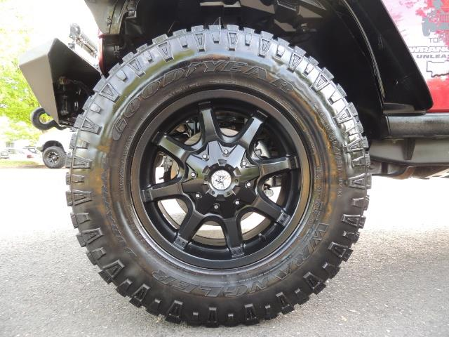 2011 Jeep Wrangler Unlimited Sport / 4X4 / 6-SPEED / LIFTED - Photo 23 - Portland, OR 97217