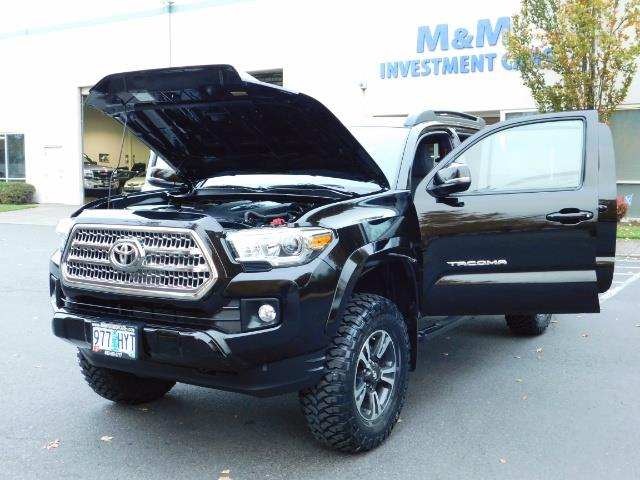 2016 Toyota Tacoma TRD Sport / 4X4 / Navigation / Backup / LIFTED - Photo 25 - Portland, OR 97217